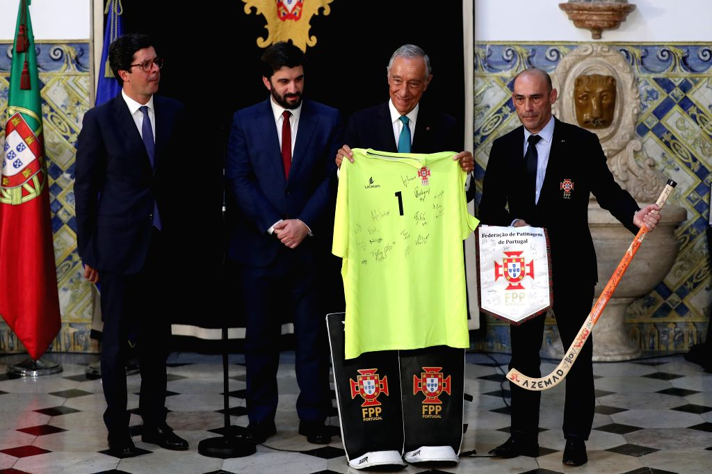 LISBON, July 17, 2019 - Portuguese President Marcelo Rebelo de Sousa (2nd R) receives a present from the Portuguese Roller Hockey Federation president Luis Senica (1st R) during the awarding ceremony ...