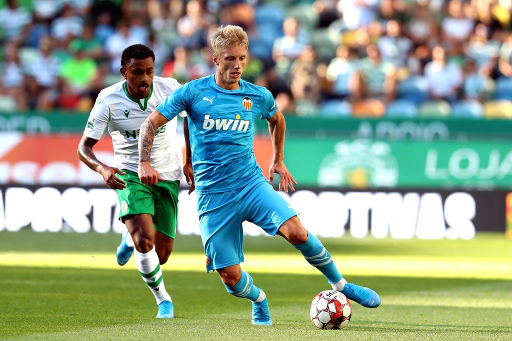 LISBON, July 29, 2019 - Daniel Wass (R) of Valencia vies with Wendel of Sporting CP during their Five Violins Trophy 2019 final football match at Alvalade stadium in Lisbon, Portugal on July 28, ...