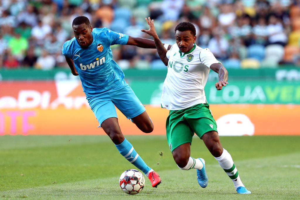 LISBON, July 29, 2019 - Wendel (R) of Sporting CP vies with Geoffrey Kondogbia of Valencia during their Five Violins Trophy 2019 final football match at Alvalade stadium in Lisbon, Portugal on July ...