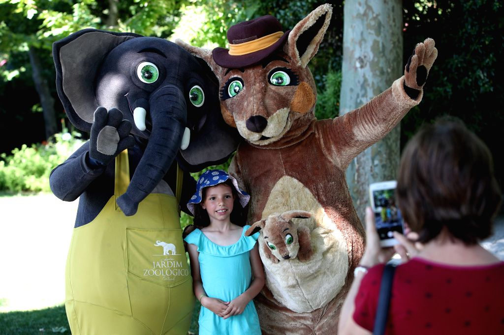 LISBON, June 1, 2019 - A child poses for a photo with costume characters at the Lisbon Zoo in Lisbon, Portugal, on June 1, 2019. On World Children's Day, the Lisbon Zoo held activities for children ...