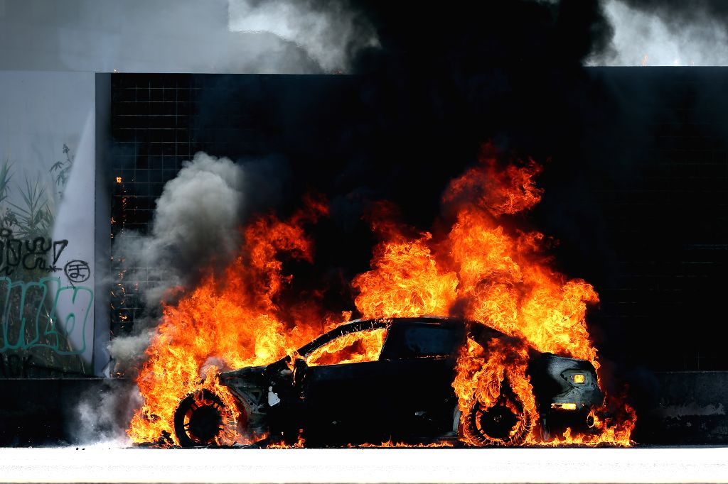 LISBON, June 10, 2019 - A car is consumed by flames on Highway 5 (A5) which connects Lisbon and Cascais, in Linda-a-Velha, Oeiras, Portugal, on June 10, 2019. The firemen had no record of any ...