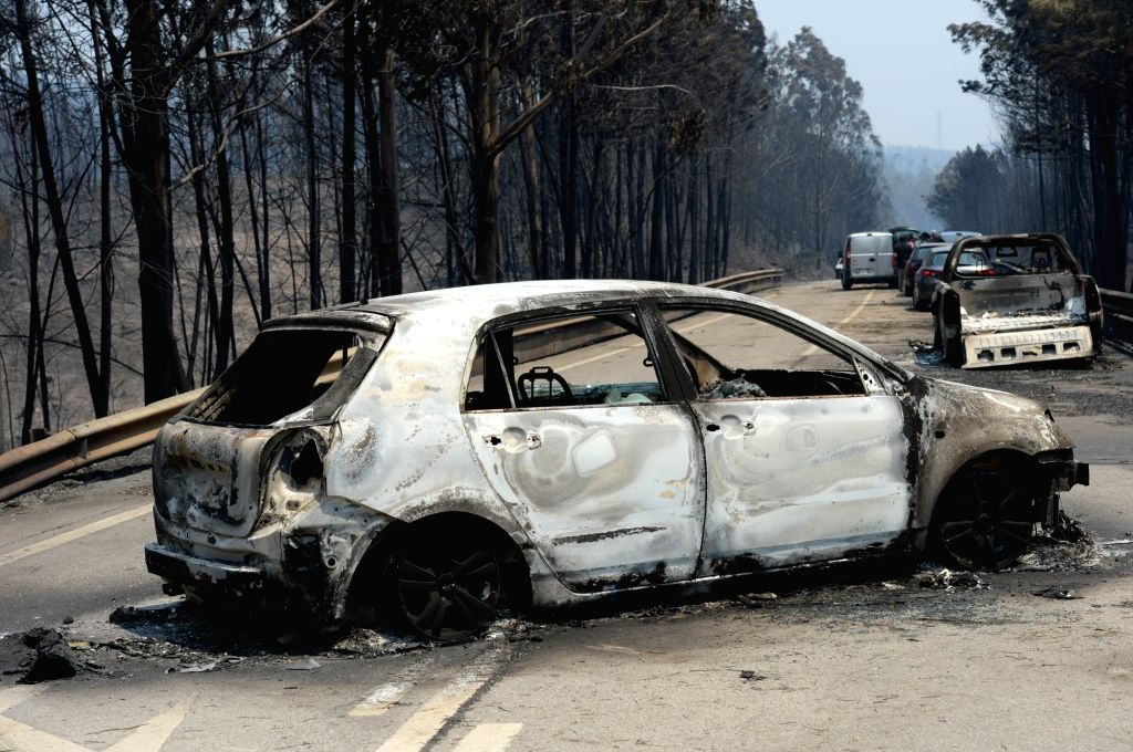 LISBON, June 18, 2017 - Photo taken on June 18, 2017 shows the wreckage of cars after the devastating forest fire in the area of Pedrogao Grande, central Portugal. The number of people killed in the ...