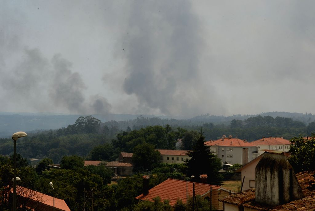 LISBON, June 18, 2017 - Smoke rises from the site of forest fire in the area of Pedrogao Grande, central Portugal on June 18, 2017. The number of people killed in the forest fire raging in central ...