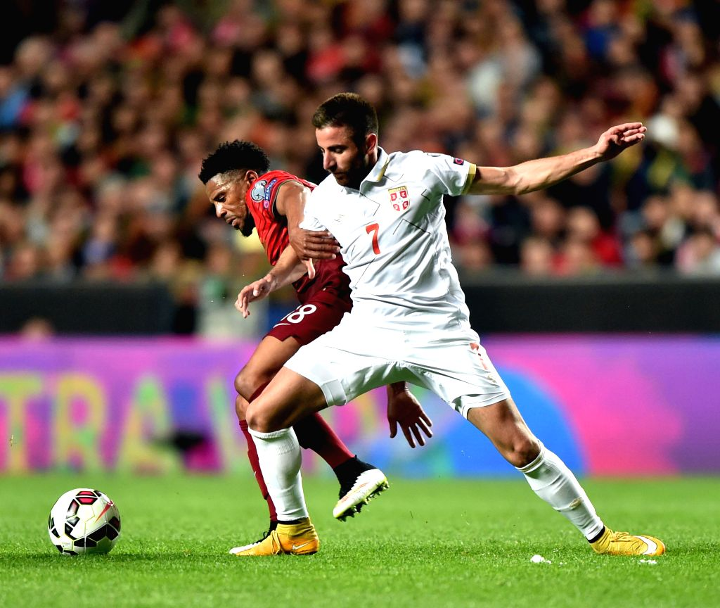 Eliseu (L) of Portugal vies with Zoran Tosic of Serbia during their UEFA Euro 2016 Group I qualifying match in Lisbon, Portugal, March 29, 2015. Portugal won 2-1. ...