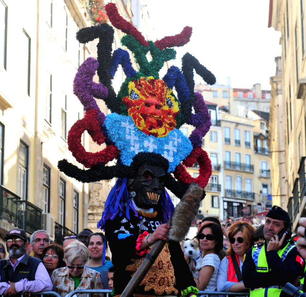 A participant performs during the parade of the 9th International Festival of the Iberian Mask in Lisbon, Portugal, May 10, 2014. About 500 masked people participated
