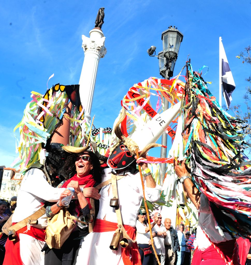 Participants perform during the parade of the 9th International Festival of the Iberian Mask in Lisbon, Portugal, May 10, 2014. About 500 masked people participated ..