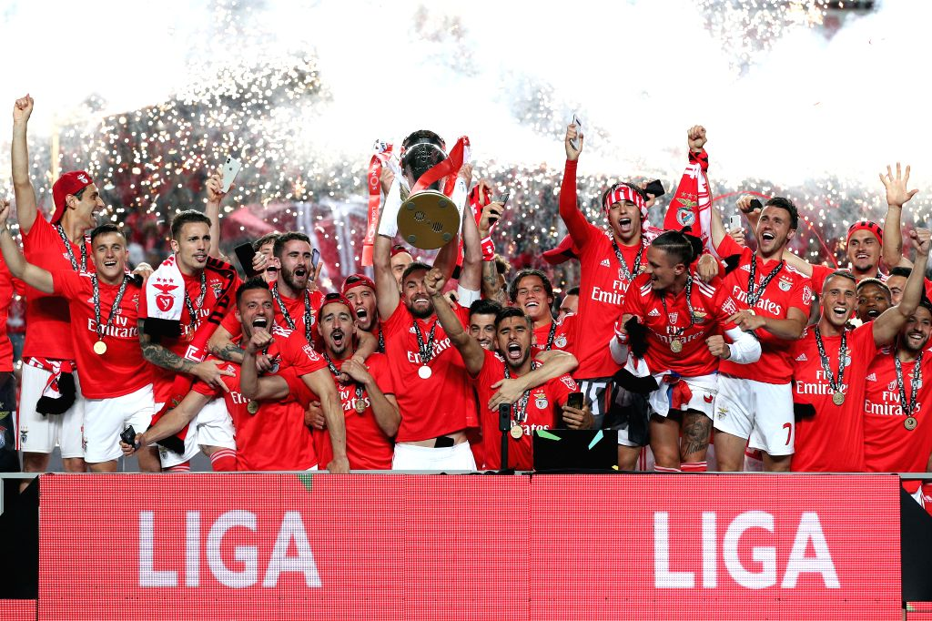 LISBON, May 19, 2019 - Team Benfica celebrates with the trophy during the awarding ceremony after winning the Champion of the Portuguese League at the Luz stadium in Porto on May 18, 2019.