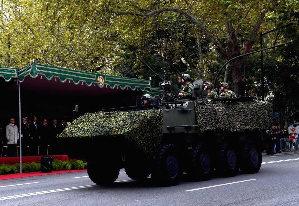 LISBON, Nov. 5, 2018 - A military vehicle marches during a military parade marking the 100th anniversary of the end of World War I (WWI) in Lisbon, Portugal, on Nov. 4, 2018. More than 4,500 soldiers ...