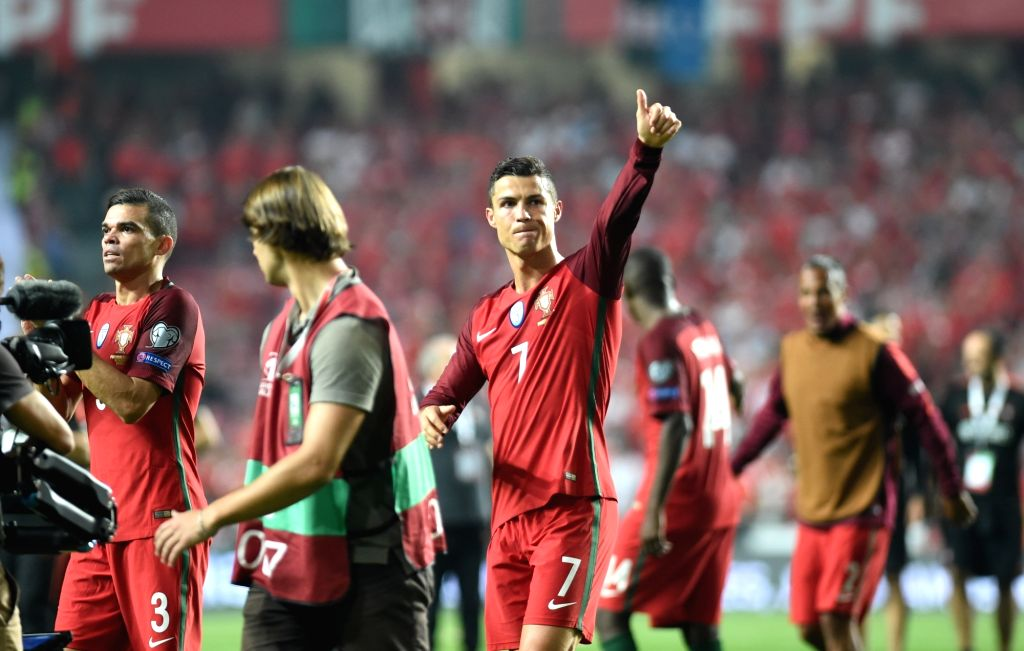 LISBON, Oct. 11, 2017 - Cristiano Ronaldo (R) of Portugal celebrates victory with his teammates after the FIFA World Cup 2018 Qualifiers Group B match between Portugal and Switzerland at the Luz ...