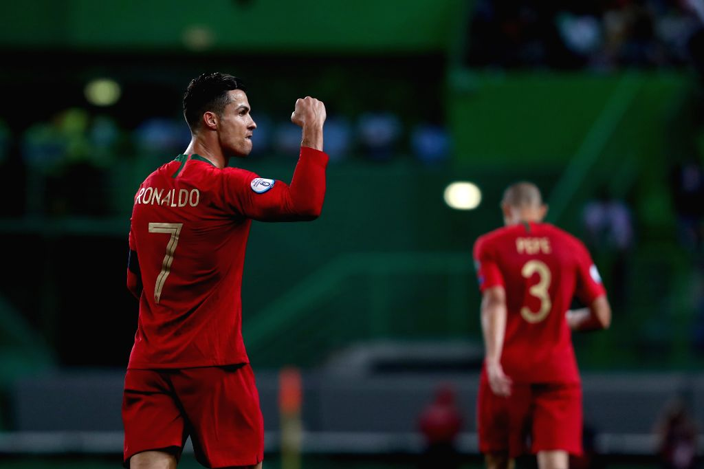 LISBON, Oct. 12, 2019 - Cristiano Ronaldo (L) of Portugal celebrates after scoring a goal during the UEFA Euro 2020 qualifying round Group B match between Portugal and Luxembourg in Lisbon, Portugal ...