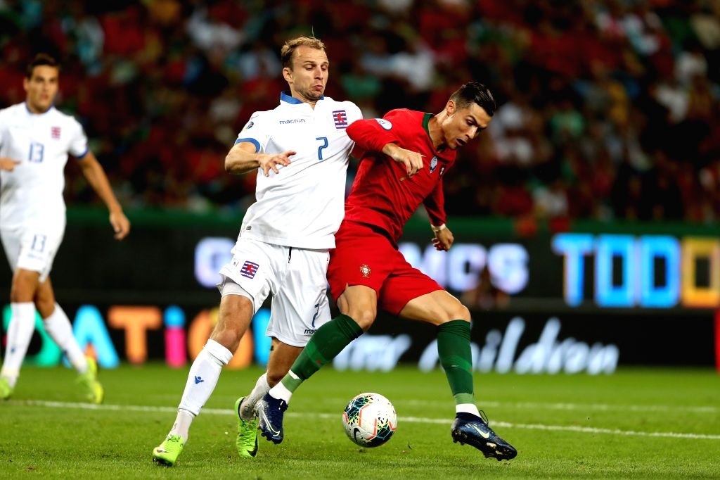 LISBON, Oct. 12, 2019 - Cristiano Ronaldo (R) of Portugal vies with Lars Gerson of Luxembourg during the UEFA Euro 2020 qualifying round Group B match between Portugal and Luxembourg in Lisbon, ...