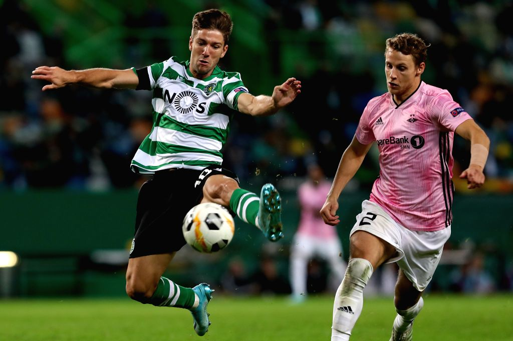 LISBON, Oct. 25, 2019 - Luciano Vietto (L) of Sporting CP vies with Vegar Hedenstad of Rosenborg BK during a UEFA Europa League Group D football match between Sporting CP and Rosenborg BK in Lisbon, ...