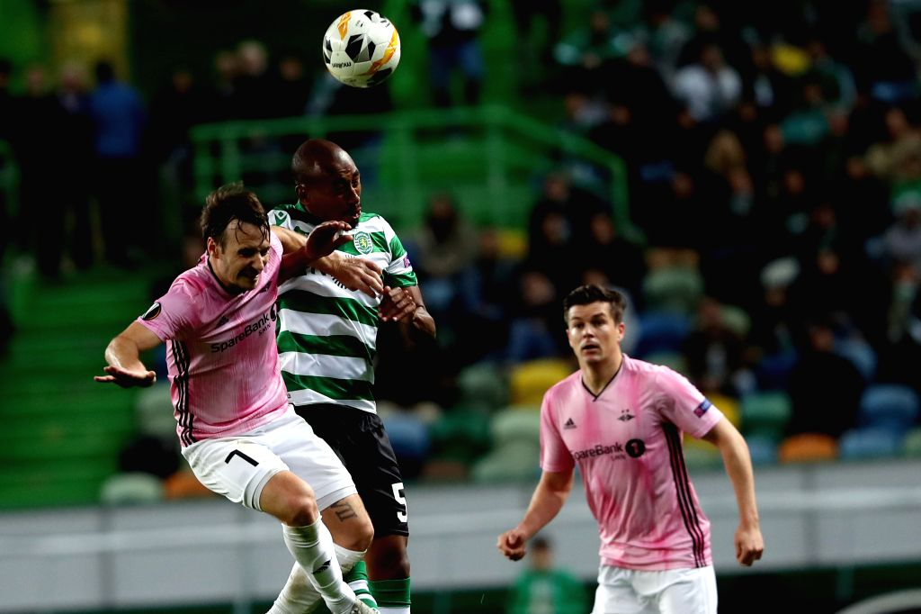LISBON, Oct. 25, 2019 - Mike Jensen (L) of Rosenborg BK vies with Eduardo Henrique (C) of Sporting CP during a UEFA Europa League Group D football match between Sporting CP and Rosenborg BK in ...