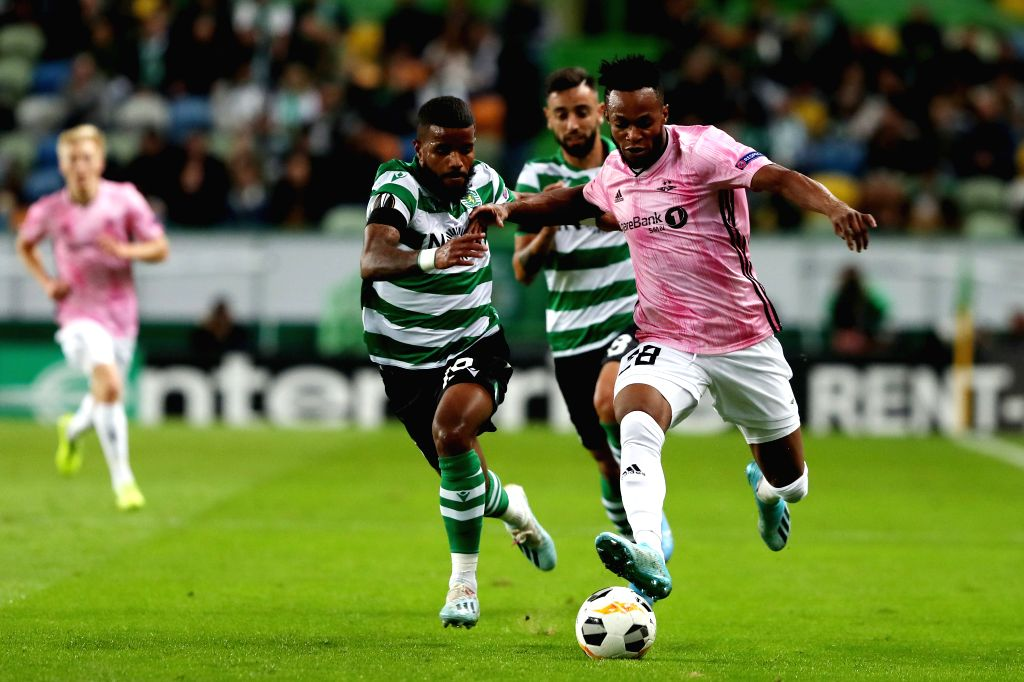 LISBON, Oct. 25, 2019 - Samuel Adegbenro (R) of Rosenborg BK vies with Valentin Rosier of Sporting CP during a UEFA Europa League Group D football match between Sporting CP and Rosenborg BK in ...