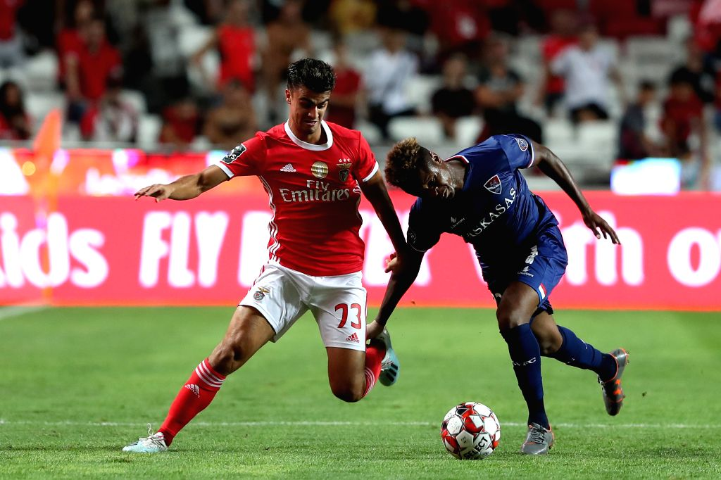 LISBON, Sept. 15, 2019 - Jota (L) of SL Benfica vies with Yves Baraye of Gil Vicente FC during the Portuguese League football match between SL Benfica and Gil Vicente FC in Lisbon, Portugal on Sept. ...