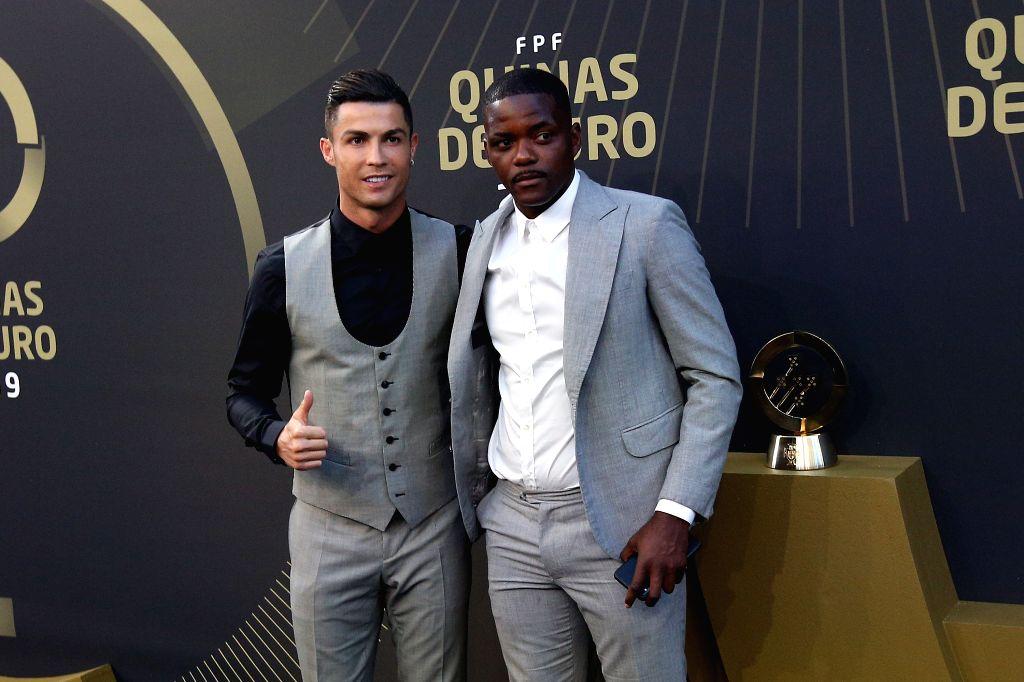 """LISBON, Sept. 3, 2019 - Portugal's forward Cristiano Ronaldo (L) and Portugal's midfielder William de Carvalho arrive for the Portuguese Football Federation """"Quinas de Ouro 2019"""" awards ..."""