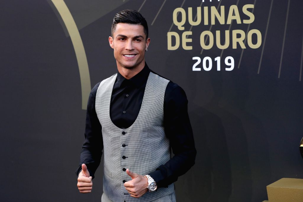 """LISBON, Sept. 3, 2019 (Xinhua) -- Portugal's forward Cristiano Ronaldo of Portugal gestures as he arrives for the Portuguese Football Federation """"Quinas de Ouro 2019"""" awards ceremony at Carlos Lopes hall in Lisbon, Portugal, on Sept. 2, 2019. (Photo"""