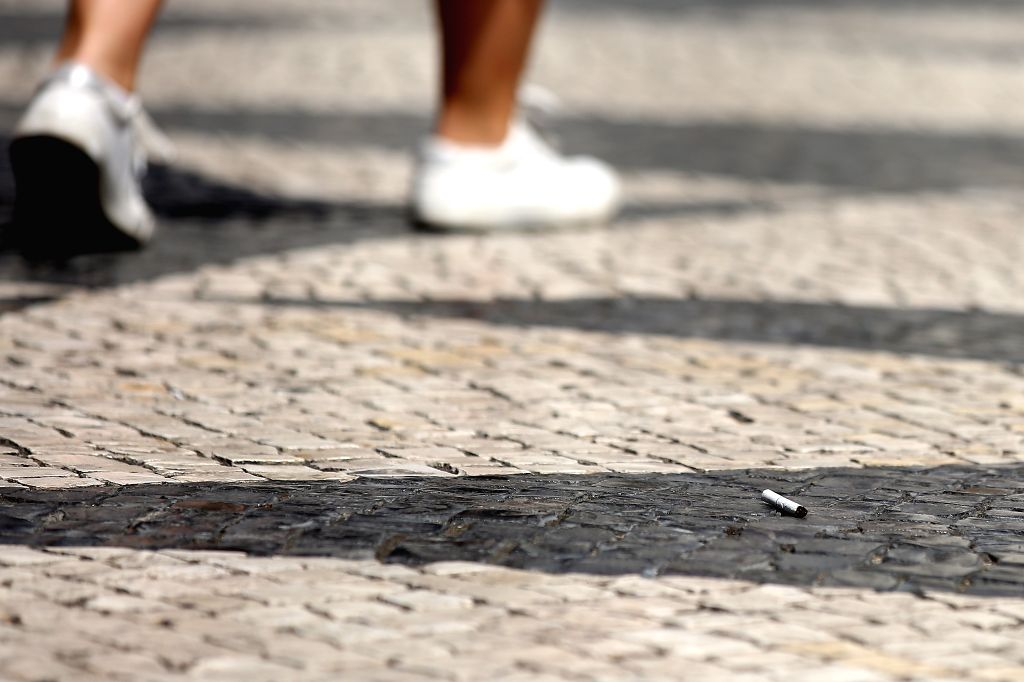LISBON, Sept. 4, 2019 - A cigarette butt is seen on the sidewalk of a street in Lisbon, Portugal, on Sept. 4, 2019. Portugal introduced on Wednesday a strict law aiming at combating smokers who throw ...