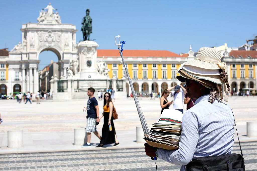 LISBON, Sept. 4, 2019 - A man sells hats in a hot day in Lisbon, Portugal, on Sept. 4, 2019. Portugal's National Authority of Emergency and Civil Protection (ANEPC) has issued a red alert to 13 ...