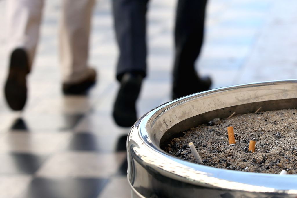 LISBON, Sept. 4, 2019 - Cigarette butts are seen in a public ashtray on the sidewalk of a street in Lisbon, Portugal, on Sept. 4, 2019. Portugal introduced on Wednesday a strict law aiming at ...