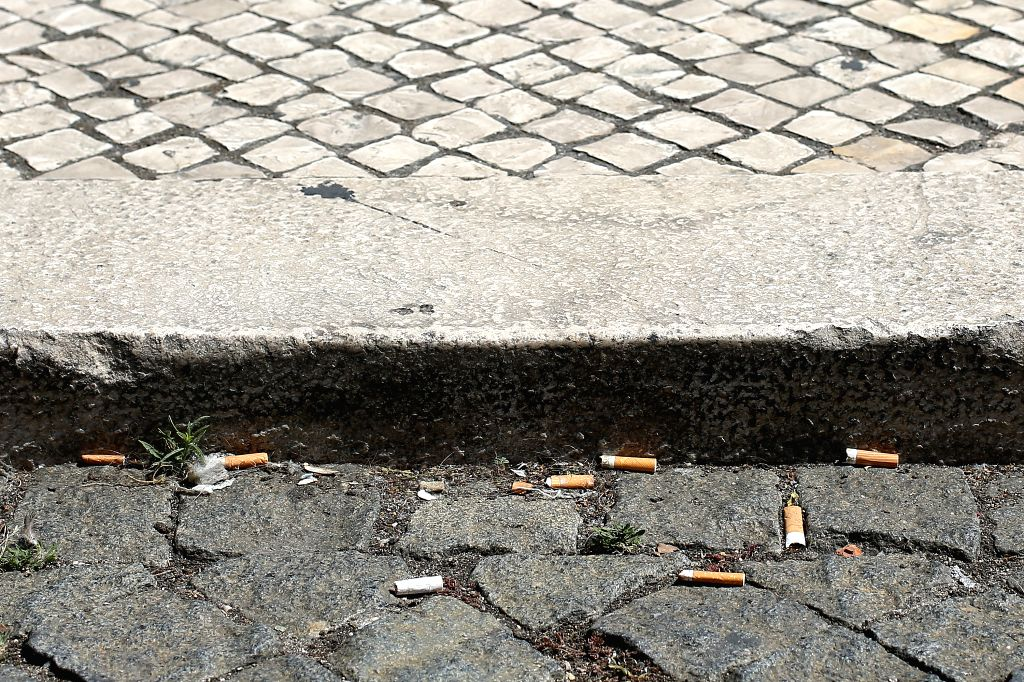 LISBON, Sept. 4, 2019 - Cigarette butts are seen on the sidewalk of a street in Lisbon, Portugal, on Sept. 4, 2019. Portugal introduced on Wednesday a strict law aiming at combating smokers who throw ...