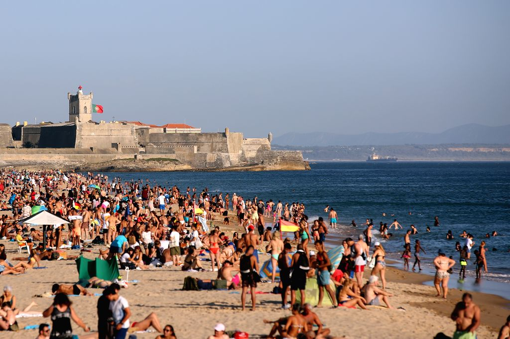 LISBON, Sept. 4, 2019 - People cool off themselves on a beach during a hot afternoon in Cascais, near Lisbon, Portugal, on Sept. 4, 2019. Portugal's National Authority of Emergency and Civil ...