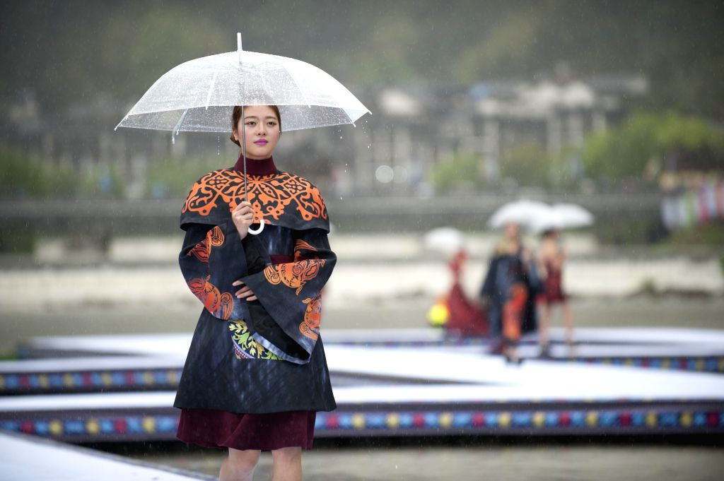 LISHUI, April 9, 2016 - A model presents a creation of She ethnic group during an outdoor fashion contest held at Jingning She Autonomous County in Lishui, east China's Zhejiang Province, April 9, ...