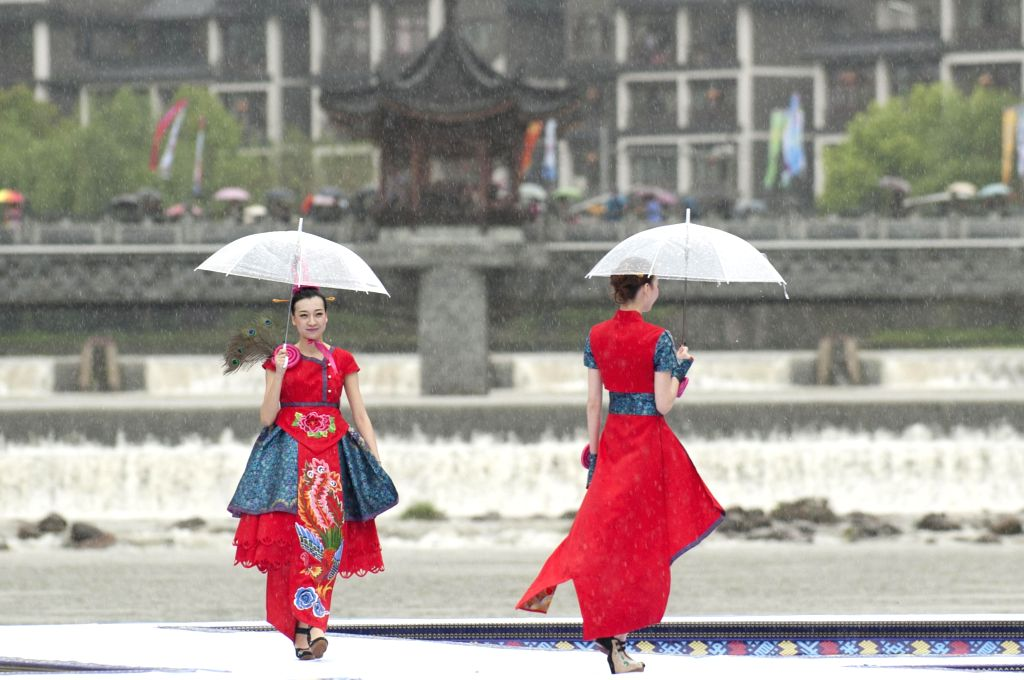 LISHUI, April 9, 2016 - Models present creations of She ethnic group during an outdoor fashion contest held at Jingning She Autonomous County in Lishui, east China's Zhejiang Province, April 9, 2016.