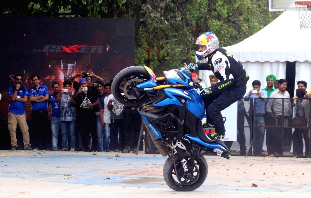 Lithuanian stunt rider Aras Gibieza displays his skills at Ramjas College on 'Suzuki Gixxer Day' in New Delhi, on April 15, 2016.