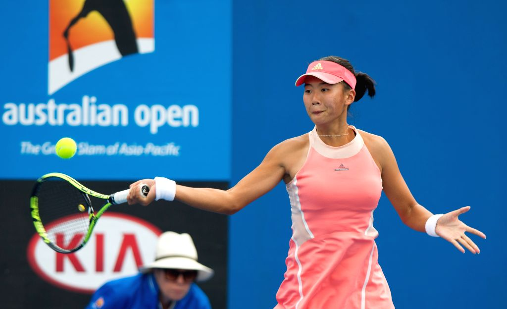 Liu Fangzhou of China returns the ball to Maria Sanchez of the United States during the women's singles first round of Australian Open qualifying match at ...