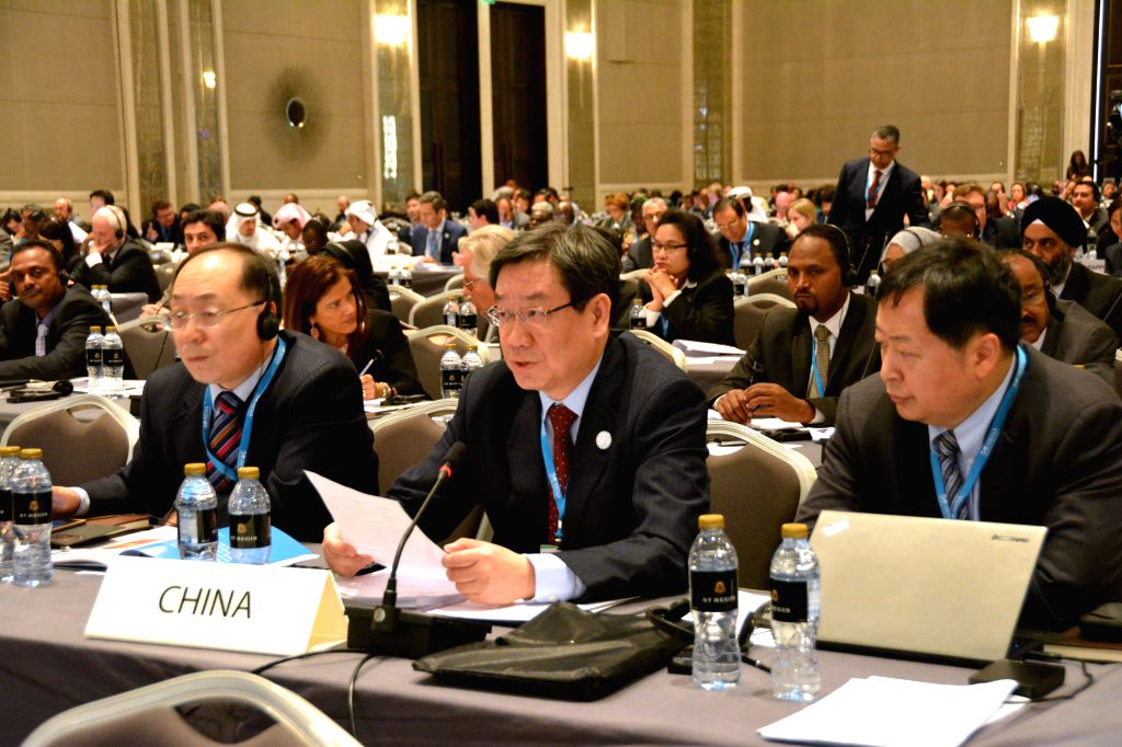 Liu Qi (C), deputy director of China's National Energy Board, speaks at the opening session of the sixth annual International Renewable Energy Agency (IRENA) ...