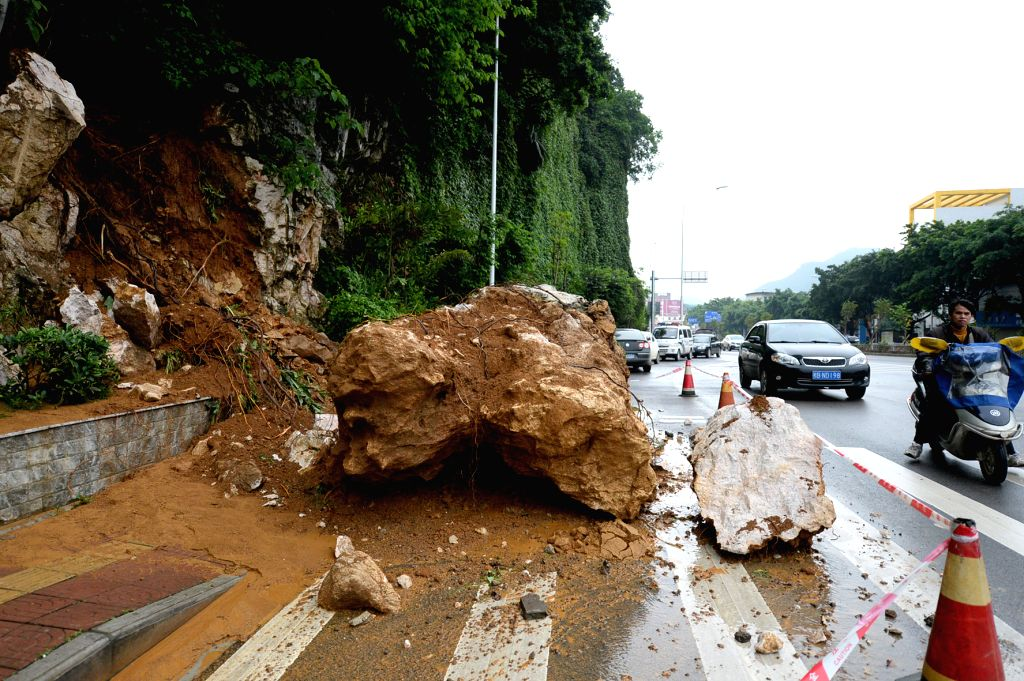 A rock blocks a road after a rainstorm in Liuzhou City, south China's Guangxi Zhuang Autonomous Region, April 26, 2014. A rainstorm lashed the city at night of ...