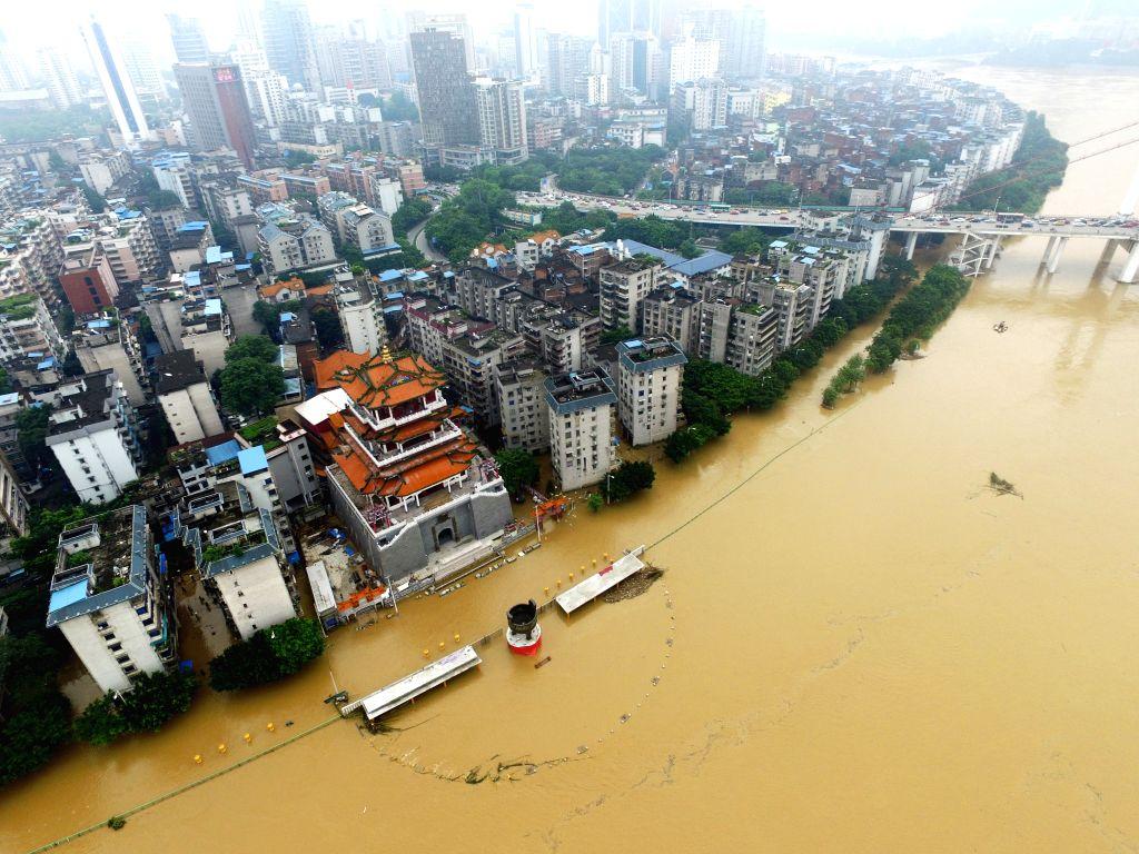 LIUZHOU, June 17, 2016 - Photo taken on June 17, 2016 shows the submerged Binjiang West Road along the Liujiang River in Liuzhou, south China's Guangxi Zhuang Autonomous Region. Water level in ...