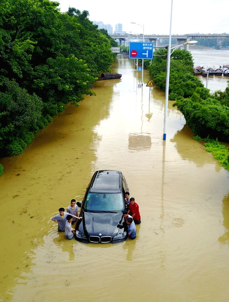 LIUZHOU, June 30 2017 Residents rescue a car in a flooded street in Liuzhou, south China's Guangxi Zhuang Autonomous Region, June 29, 2017. Influenced by recent heavy rains, the water ...