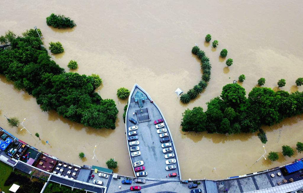 LIUZHOU, June 30 2017 The Binjiang West Road along the riverside of Liujiang River is flooded in Liuzhou, south China's Guangxi Zhuang Autonomous Region, June 29, 2017. Influenced by ...