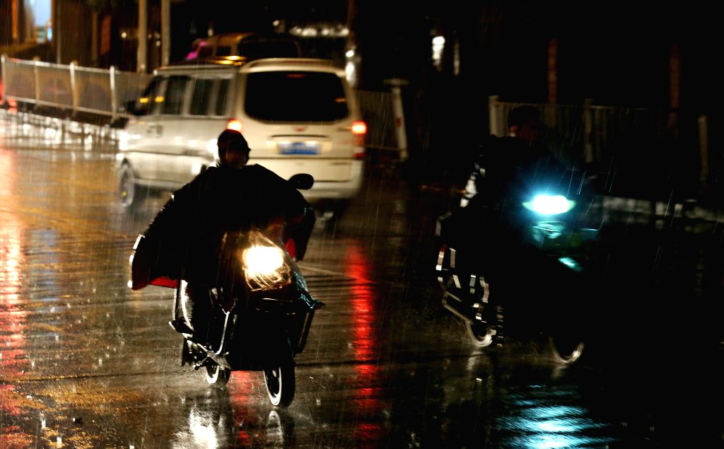 LIUZHOU, May 20, 2016 - Motorcyclists ride in rain in Chang'an Town of Rong'an County in Liuzhou, south China's Guangxi Zhuang Autonomous Region, May 19, 2016.