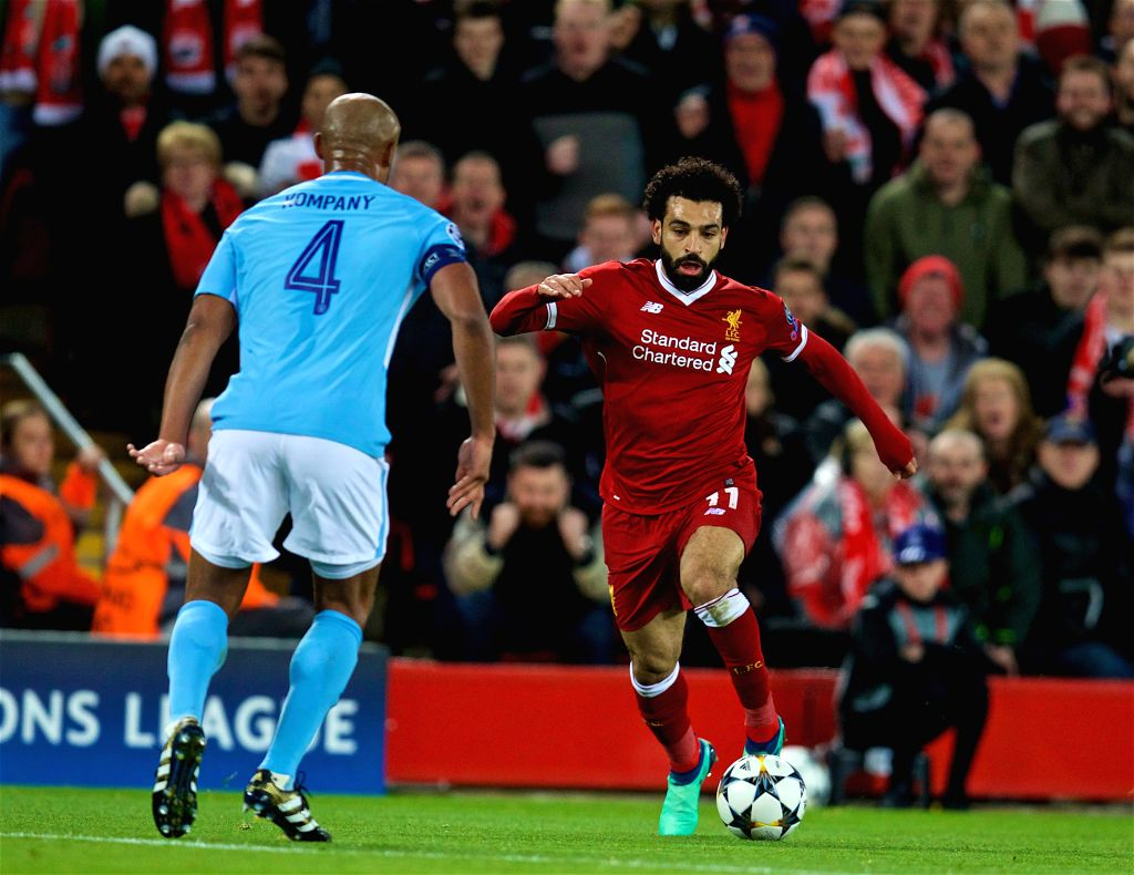 LIVERPOOL, April 5, 2018 - Mohamed Salah (R) of Liverpool breaks through during the UEFA Champions League quarterfinal 1st Leg match between Liverpool and Manchester City at Anfield Stadium in ...