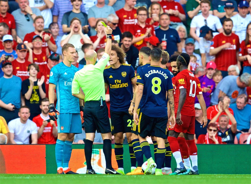 LIVERPOOL, Aug. 25, 2019 - Arsenal's David Luiz (3rd L) is shown a yellow card after conceding a penalty during the English Premier League match between Liverpool FC and Arsenal FC at Anfield in ...