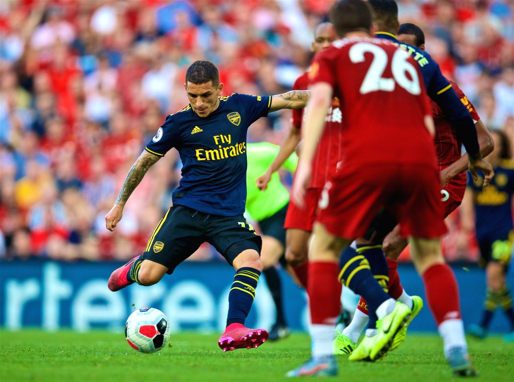 LIVERPOOL, Aug. 25, 2019 - Arsenal's Lucas Torreira (L) shoots to score a goal during the English Premier League match between Liverpool FC and Arsenal FC at Anfield in Liverpool, Britain on Aug. 24, ...