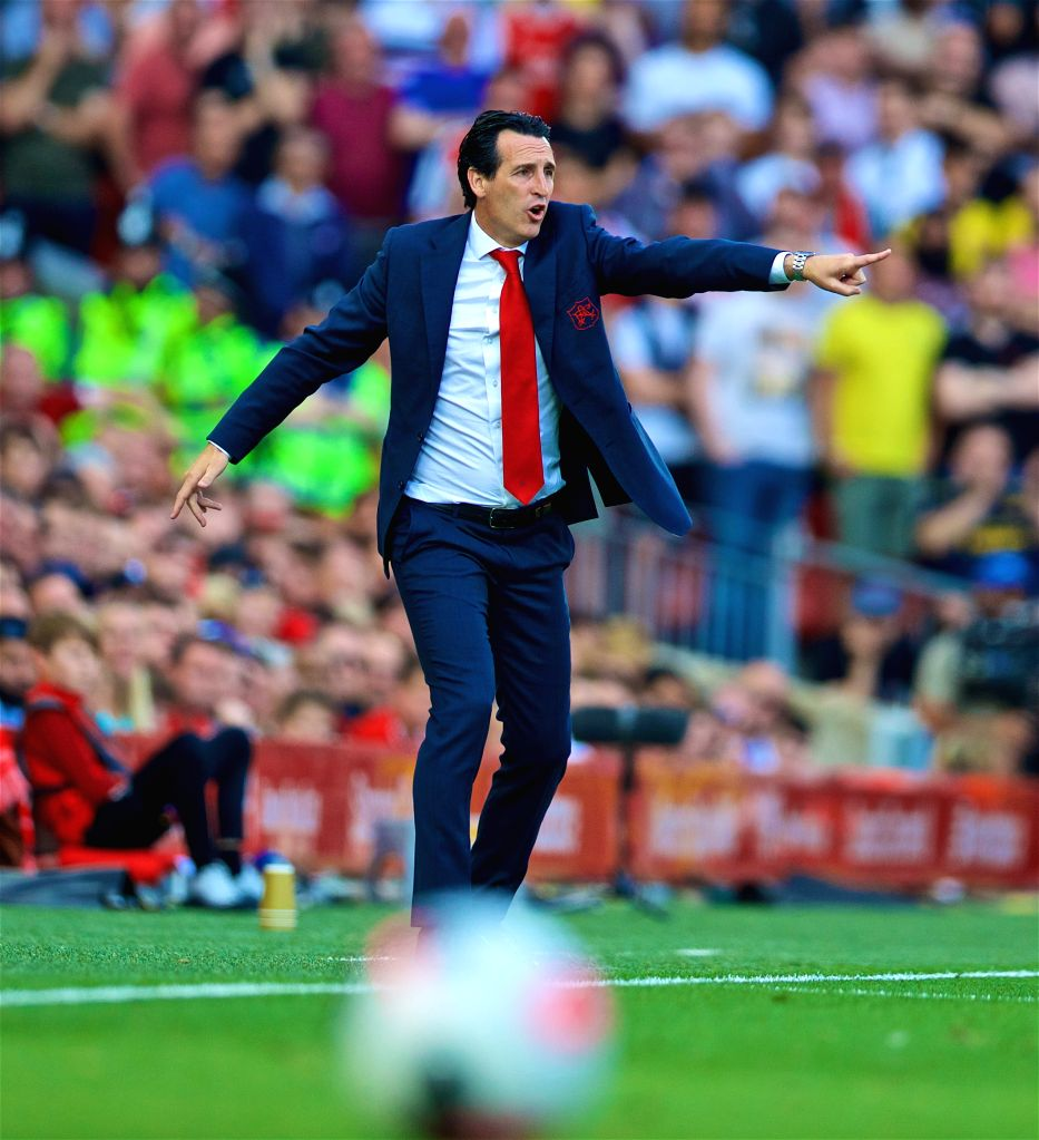 LIVERPOOL, Aug. 25, 2019 - Arsenal's manager Unai Emery reacts during the English Premier League match between Liverpool FC and Arsenal FC at Anfield in Liverpool, Britain on Aug. 24, 2019.