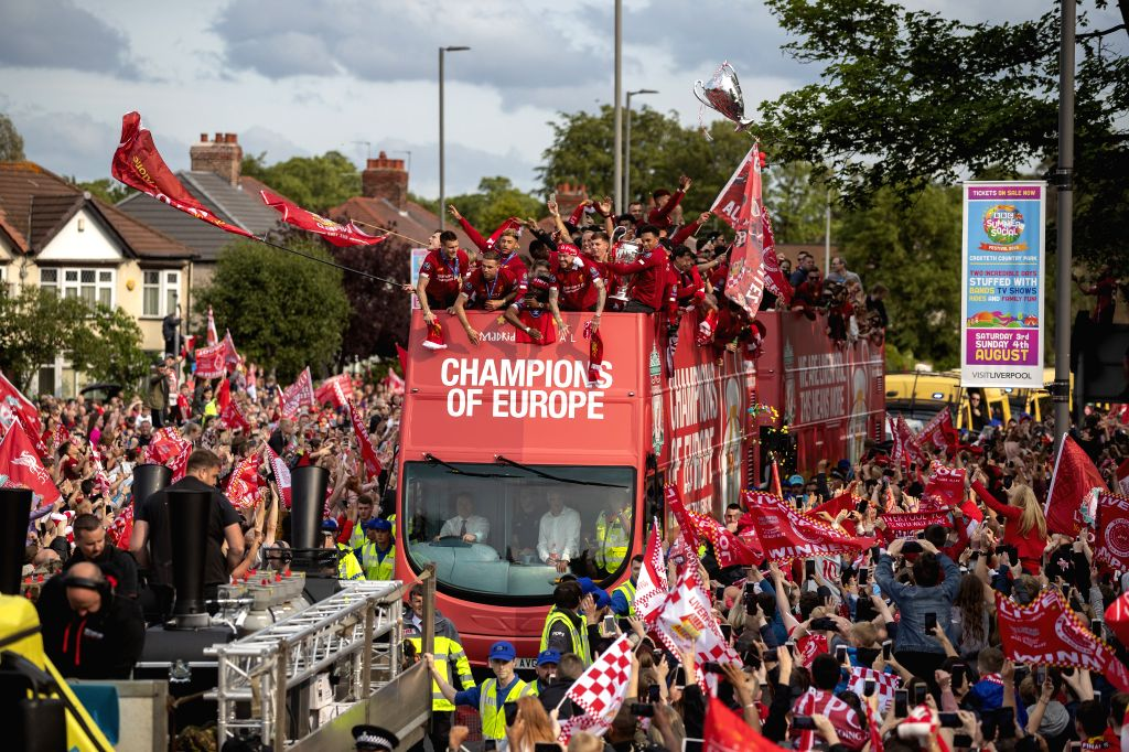 LIVERPOOL, June 3, 2019 - Liverpool's players are cheered by their supporters during an open-topped bus parade through the city after winning the UEFA Champions League Final in Liverpool, Britain on ...