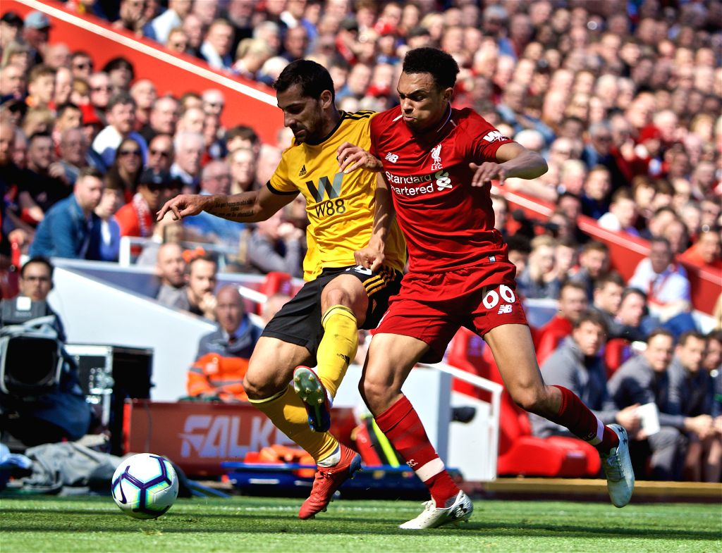 LIVERPOOL, May 13, 2019 - Liverpool's Trent Alexander-Arnold (R) vies with Wolverhampton Wanderers' Jonny Castro during the final English Premier League match of the season between Liverpool and ...