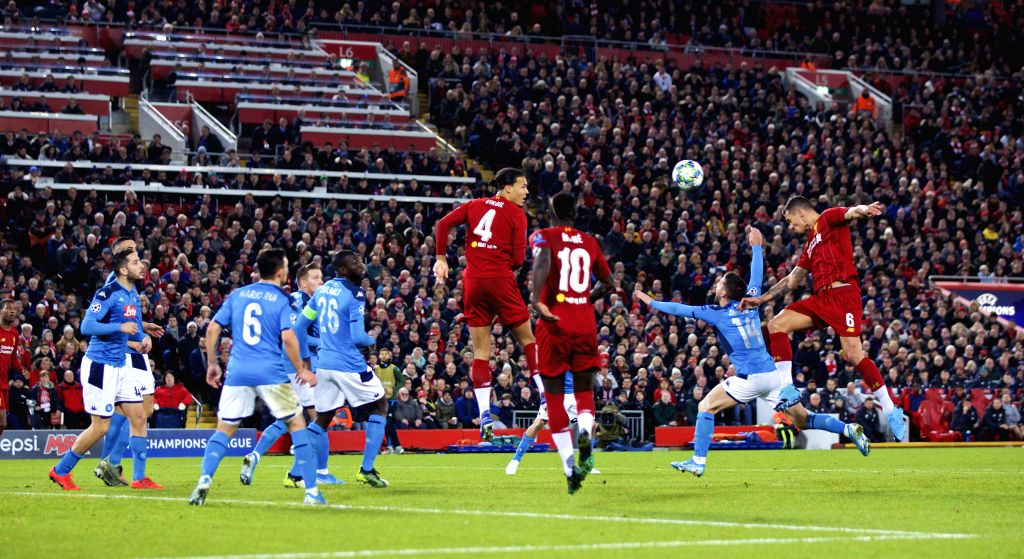 LIVERPOOL, Nov. 28, 2019 (Xinhua) -- Liverpool's Dejan Lovren (1st R) scores during the UEFA Champions League Group E match between Liverpool and Napoli at Anfield in Liverpool, Britain on Nov. 27, 2019. (Xinhua/IANS)