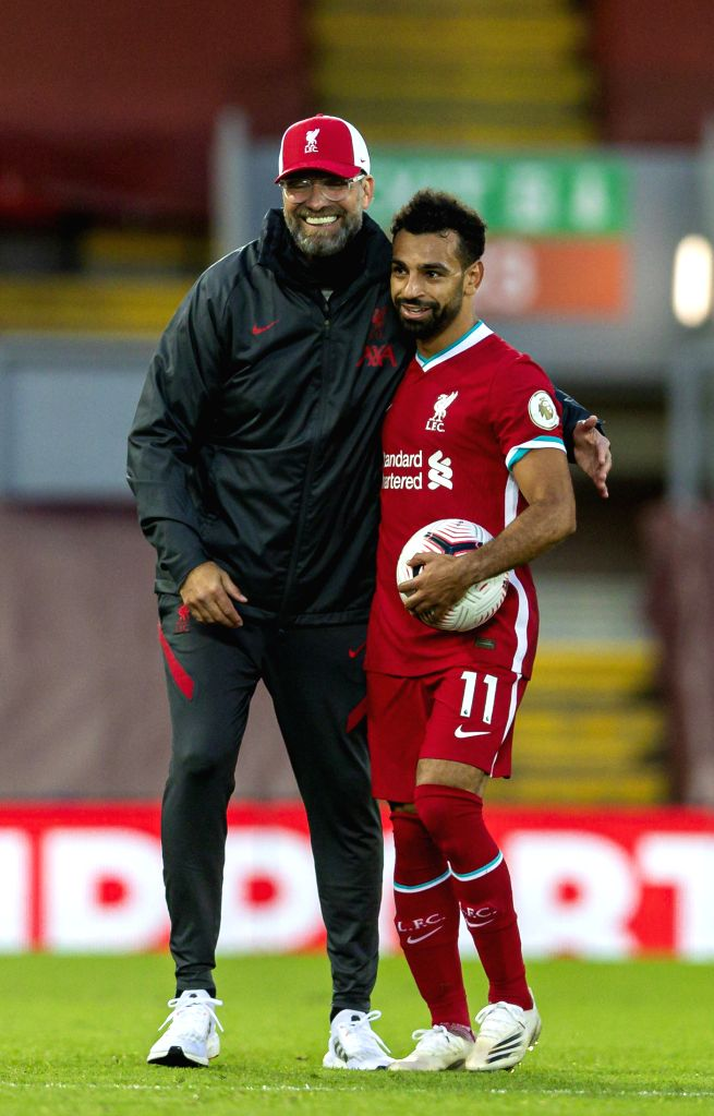 Liverpool's manager Jurgen Klopp (L) congratulates hat-trick hero Mohamed Salah after the English Premier League match between Liverpool FC and Leeds United FC ...