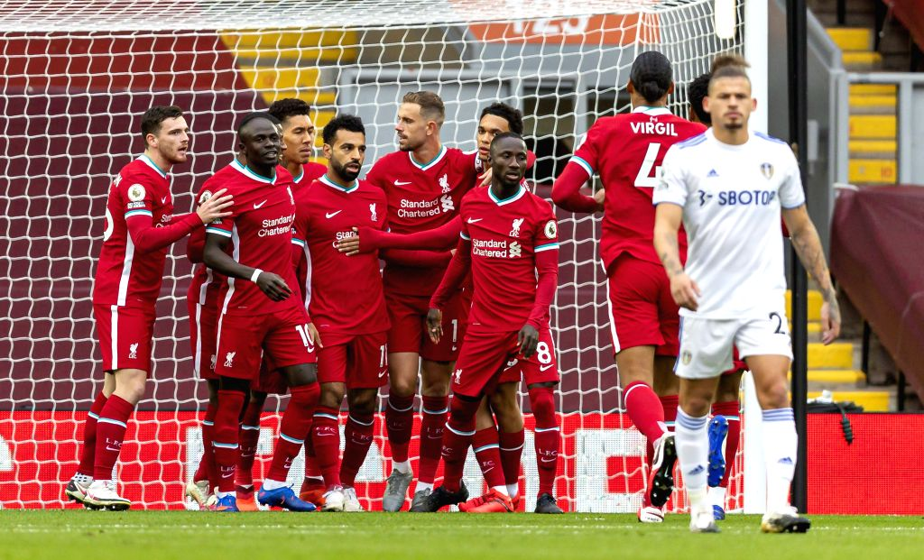 Liverpool's Mohamed Salah (4th L) celebrates with teammates after scoring a goal from a penalty kick during the English Premier League match between Liverpool FC ...