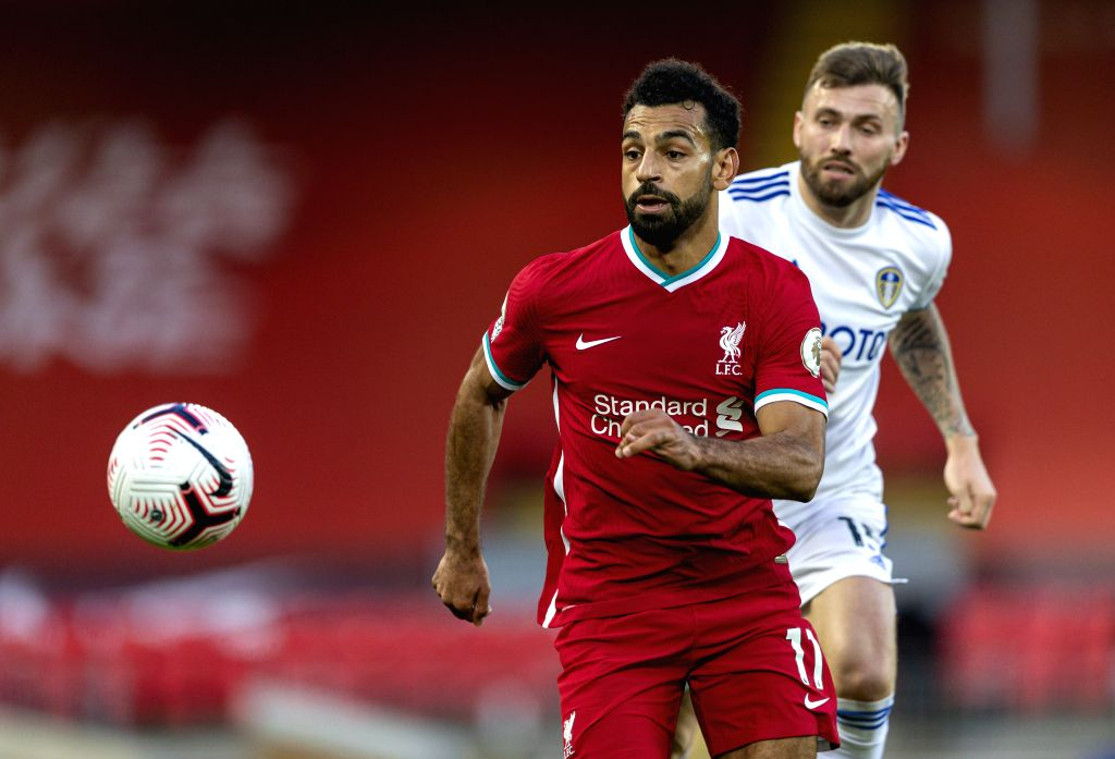 Liverpool's Mohamed Salah (L) chases the ball during the English Premier League match between Liverpool FC and Leeds United FC at Anfield in Liverpool, Britain, ...