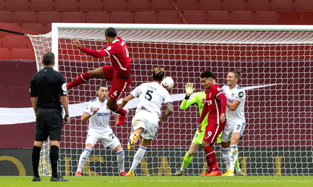 Liverpool's Virgil van Dijk (Above) heads the ball and scores during the English Premier League match between Liverpool FC and Leeds United FC at Anfield in ...