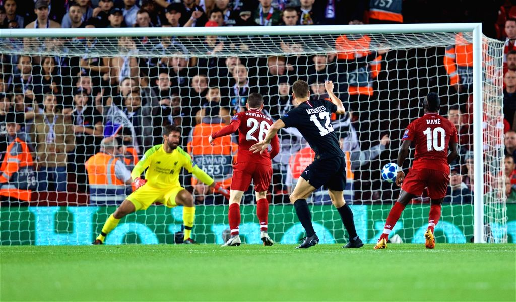 LIVERPOOL, Sept. 19, 2018 - Liverpool's goalkeeper Alisson Becker (1st L) and Andy Robertson (2nd L) look on as Paris Saint-Germain's Thomas Meunier (2nd R) scores a goal during the UEFA Champions ...
