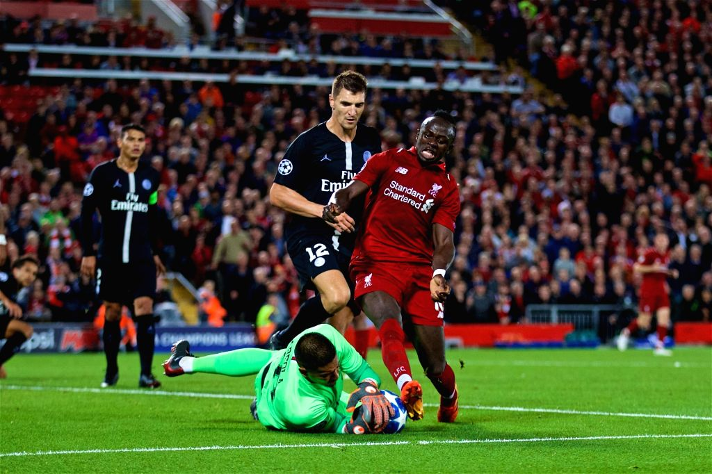 LIVERPOOL, Sept. 19, 2018 - Liverpool's Sadio Mane (R), Paris Saint-Germain's goalkeeper Alphonse Areola (Bottom) and Thomas Meunier (2nd R) compete during the UEFA Champions League Group C match ...