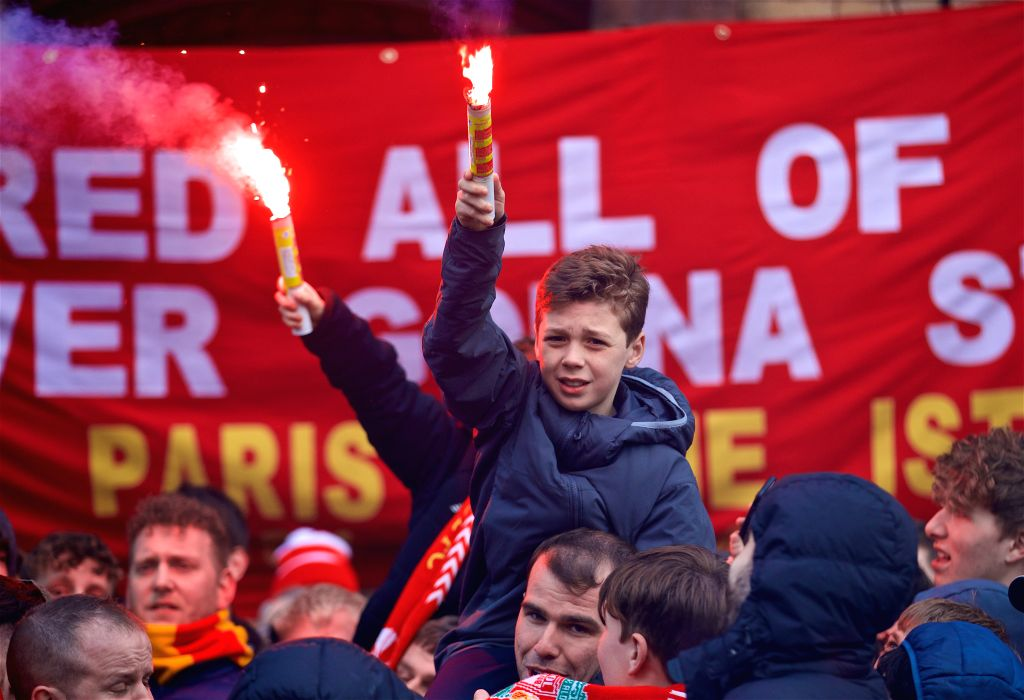 : Liverpool supporters welcome the team buses before the UEFA Champions League Quarter-Final 1st Leg match between Liverpool and Manchester City at Anfield ...